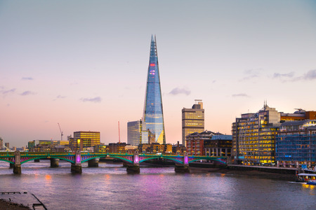 shard of glass: LONDON, UK - DECEMBER 19, 2014: Shard of glass in the dusk. City of London business aria. Thames view from the bridge Editorial