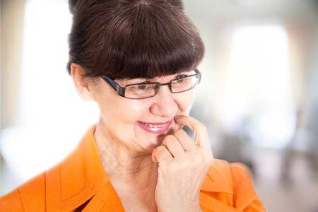 good looking woman: Pension age good looking woman portrait Stock Photo