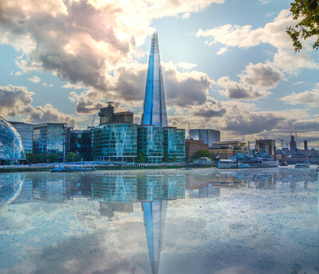 south london: LONDON, UK - AUGUST 16, 2014: Shard of glass on river Thames. Modern London architecture Editorial