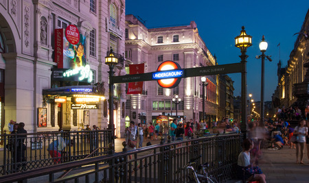 piccadilly: LONDON, UK - AUGUST 22, 2014: Piccadilly Circus in night. Famous place for romantic dates. Square was built in 1819 to join of Regent Street Editorial