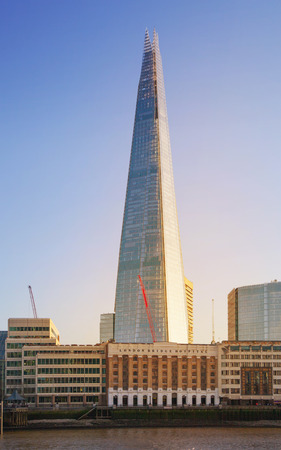 shard of glass: LONDON, UK - APRIL15, 2015: Shard of glass in sunset. Panoramic view of south bank river Thames walk.