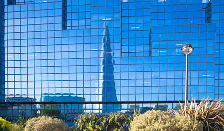shard of glass: LONDON, UK - APRIL15, 2015: Reflection of Shard and blue sky in modern glass building City of London, south bank of river Thames walk. Editorial