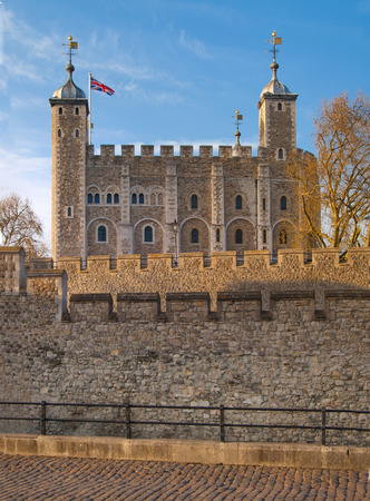 LONDON, UK - APRIL15, 2015: Tower of London (started 1078), old fortress, castle, prison and house of Crown Jewels. View form the river side park