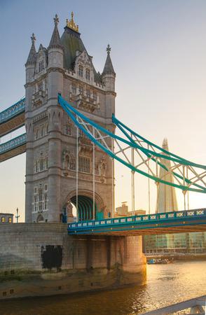 south london: LONDON, UK - APRIL15, 2015: Tower bridge in sunset. City of London, south bank of river Thames walk.