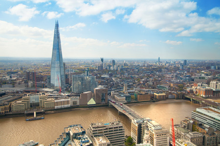 shard: LONDON UK  APRIL 22 2015: City of London panorama includes river Thames bridges  Shard of glass Editorial