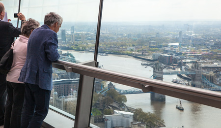 seance: LONDON UK  APRIL 22 2015: People looking at the Londons skyline. Viewing platform of WalkieTalkie building. Locates on 32 floor and offering amazing view of the city. Editorial