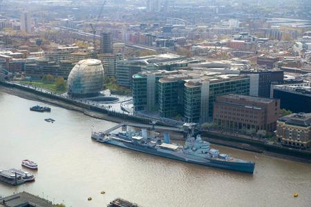 LONDON UK  APRIL 22 2015: City of London panorama includes river Thames and old battle ship Redakční