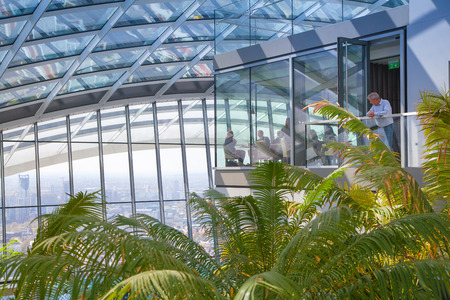 heist: LONDON UK  APRIL 22 2015: People in the restaurant of the Sky Garden WalkieTalkie building. Viewing platform is heist UK garden locates at the 32 floor and offers amazing skyline of London city. Editorial