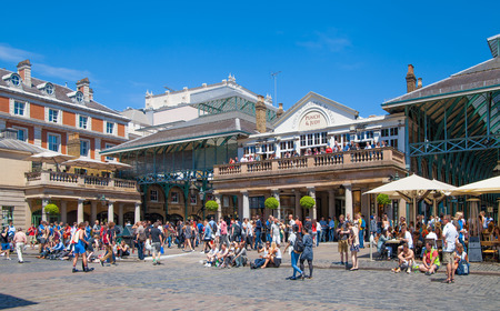covent: LONDON UK  22 JULY 2014: Covent Garden market one of the main tourist attractions in London known as restaurants pubs market stalls shops and public entertaining. Editorial