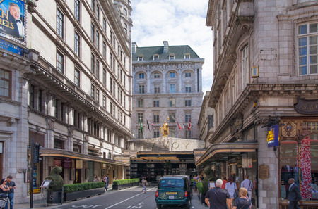 glitzy: LONDON UK  22 JULY 2014: Savoy hotel one of the best holes in London and Europe. Main entrance and taxi averting the client Editorial