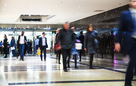 Business people moving blur. People walking in rush hour. Business and modern life concept Editorial