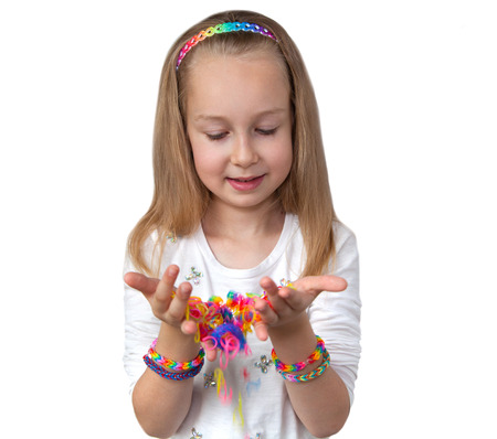 rubber bands: Loom bands craft. Little girl holding colourful loom in her hands
