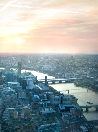 LONDON UK  APRIL 15 2015: City of London panorama in sunset. River Thames and bridges photo