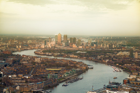 canary wharf: City of London panorama in sunset. Canary Wharf aria and River Thames