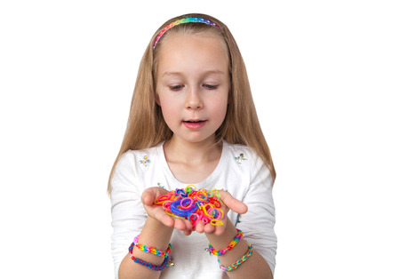 accessorize: Loom bands craft. Little girl holding colourful loom in her hands