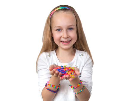 loom: Loom bands craft. Little girl holding colourful loom in her hands