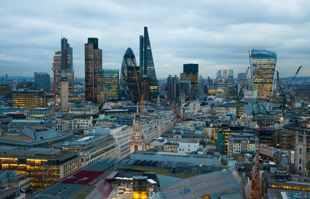LONDON UK  JANUARY 27 2015: City of London business and banking area. Londons panorama at sun set. Editorial