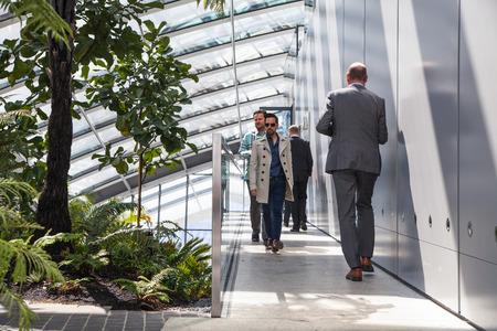 seance: LONDON UK  APRIL 22 2015: Business people walking top floor of WalkieTalkie building.