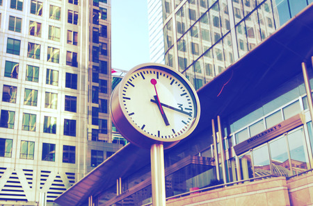 LONDON CANARY WHARF UK  JUNE 2 2015:  Clock at the Canary Wharf square. Business symbol