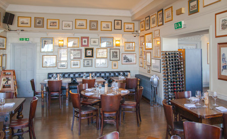 public house: LONDON, UK - APRIL 14, 2015: Old English victorian public house interior. Early morning settings with no people