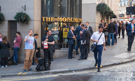 british food: LONDON, UK - APRIL15, 2015: Exterior of pub in the City of London with lots of people drinking and socialising after work. Editorial