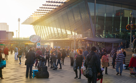 tube station: LONDON, UK - NOVEMBER 29, 2014: Stratford international train and tube station, one of the biggest transport junction of London and UK. Main hall with lots of people