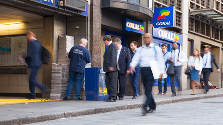 tube station: LONDON, UK - APRIL15, 2015: City of London, tube commuters walking in front of Londons tube station.
