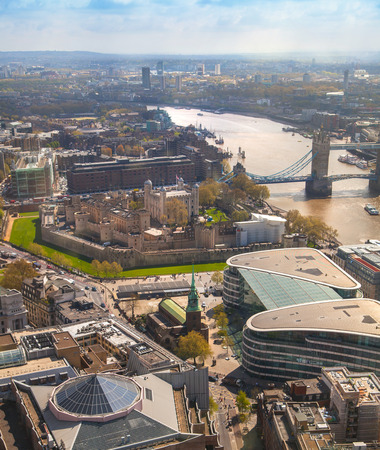 high view: LONDON, UK - APRIL 22, 2015:  Tower bridge, Tower of London and river Thames. Panoramic view from the 32 floor of Londons skyscraper