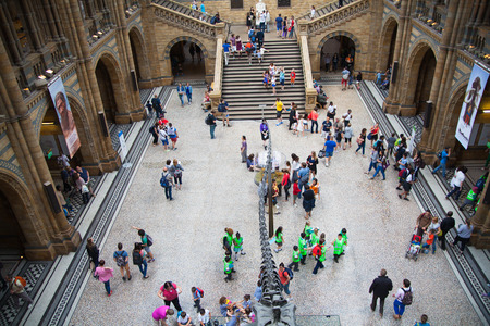 exhibition crowd: LONDON, UK - AUGUST 11, 2014: National History Museum, is one of the most favourite museum for families in London.