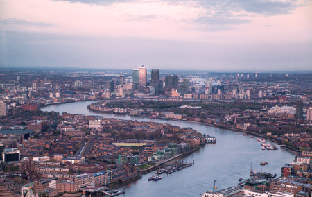 thames: LONDON, UK - APRIL 15, 2015: City of London panorama in sunset. Tower bridge and river Thames Editorial