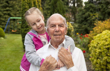 fellings: 95 years old english man with granddaughter in garden