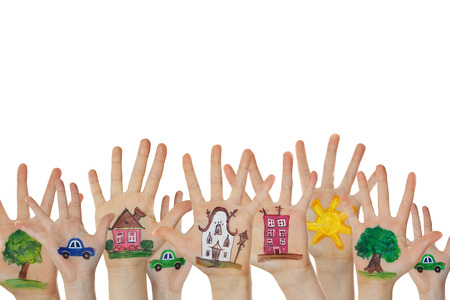 raise hand: Abstract street made of painted symbols. Houses, trees, cars painted on children hands raised up.