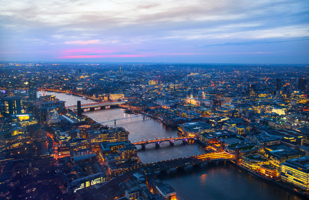 city night: City of London panorama at sunset. First night lights and river Thames Editorial