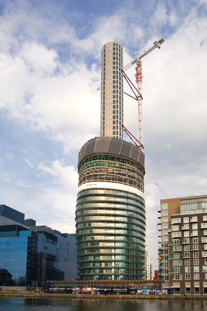 uk: LONDON, UK - May 21, 2015: One of the tallest apartment buildings in London in construction progress