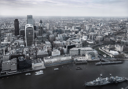 aerial: LONDON, UK - APRIL 15, 2015: City of London panorama in sunset. Famous Londons office buildings with Walkie-Talkie in front