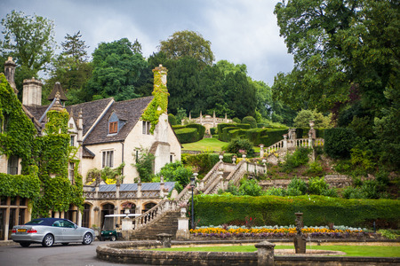 country club: CHIPPENHAM, UK - AUGUST 9, 2014: Castle Combe, unique old English village. Old house and park