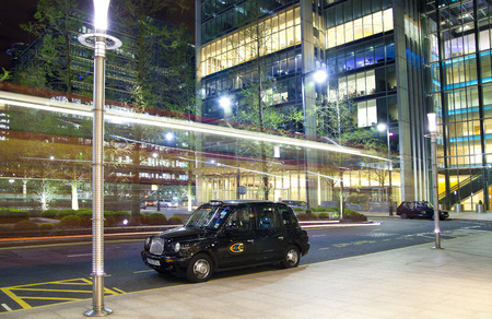 office buildings: LONDON, CANARY WHARF UK - APRIL 4, 2014: Canary Wharf at night
