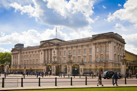 elizabeth: LONDON, UK - MAY 14, 2014: Buckingham Palace the official residence of Queen Elizabeth II and one of the major tourist destinations U.K. Entrance and main gate with lanterns Editorial
