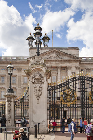 main gate: LONDON, UK - MAY 14, 2014: Buckingham Palace the official residence of Queen Elizabeth II and one of the major tourist destinations U.K. Entrance and main gate with lanterns Editorial