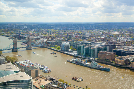 thames: LONDON, UK - APRIL 22, 2015: Tower bridge and River Thames. Panoramic view from the 32 floor of Londons skyscraper
