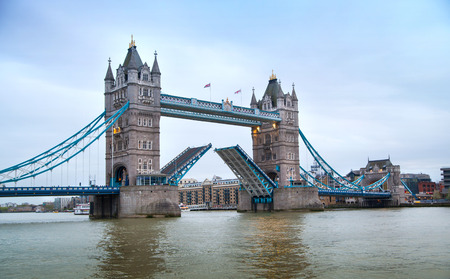 towers: Tower bridge open. View from the River Thames Editorial