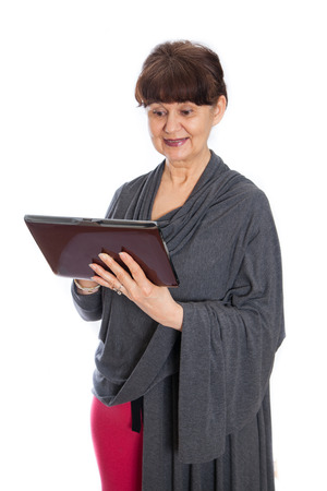 woman searching: Pension age good looking woman searching in the internet