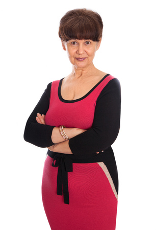 65 years old: 65 years old woman portrait against of white background.  Pension age good looking woman smiling