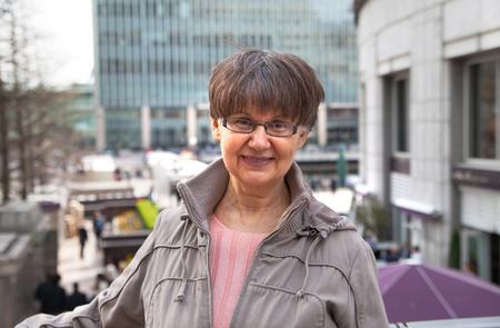 good looking woman: Pension age good looking woman portrait in the City. London Stock Photo