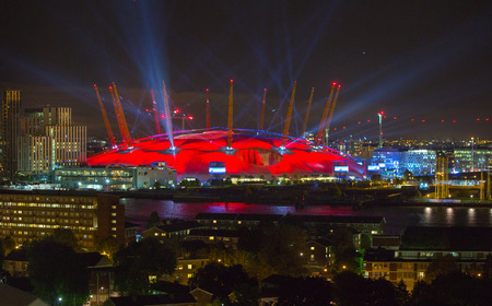 abstract london: LONDON, UK - 8 SEPTEMBER, 2015: London arena under light performing. City lights background.