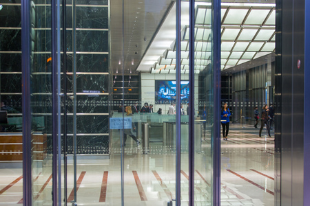 office life: LONDON, UK - 7 SEPTEMBER, 2015: Office building entrance in night light. Canary Wharf night life