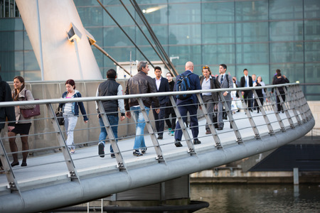 canary wharf: LONDON, UK - 7 SEPTEMBER, 2015: Canary Wharf business life. Business people going home after working day.