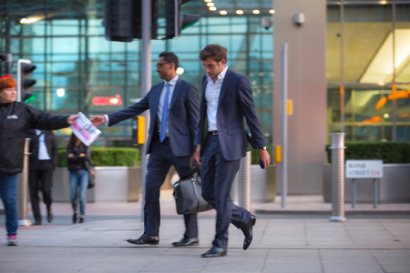 business life: LONDON, UK - 7 SEPTEMBER, 2015: Canary Wharf business life. Business people going home after working day.