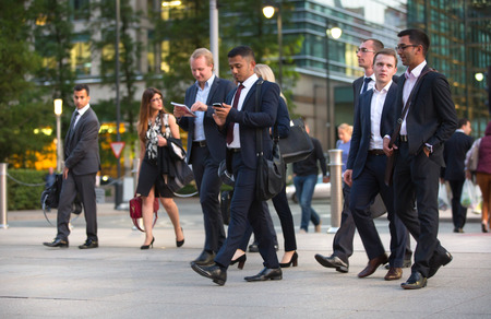 office life: LONDON, UK - 7 SEPTEMBER, 2015: Canary Wharf business life. Business people going home after working day.