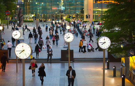 uk money: LONDON, UK - 7 SEPTEMBER, 2015: Canary Wharf business life. Business people going home after working day.